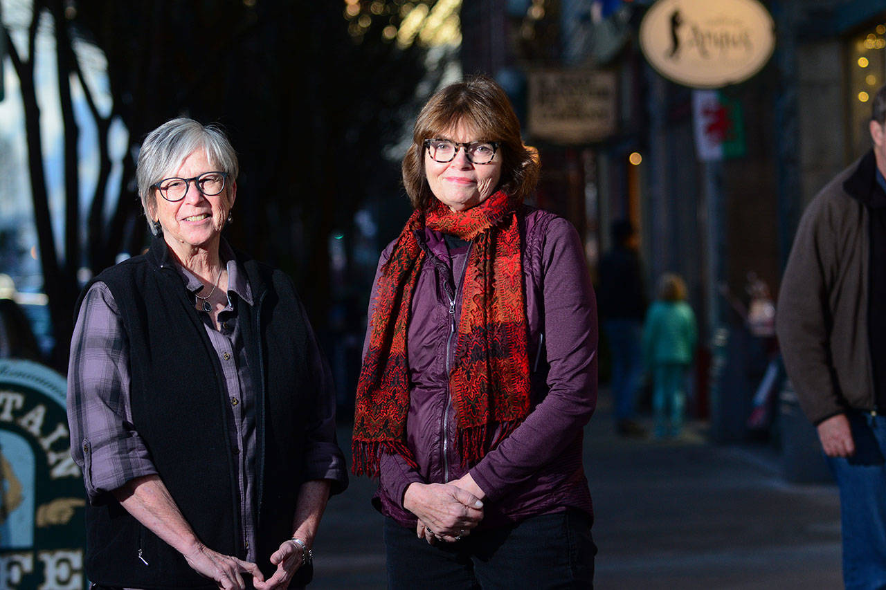 Sandy Spencer, Port Townsend Main Street board member, left, and Executive Director Mari Mullen are preparing a campaign to help downtown businesses thrive during the six months of Water Street construction that is scheduled to begin Jan. 2. (Jesse Major/Peninsula Daily News)